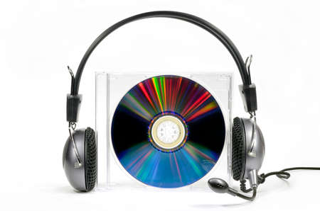 Headphones on compact disk in box against white background Stock Photo