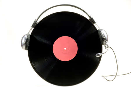 Headphones with microphone worn by vinyl record album on white background Stock Photo