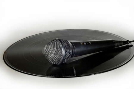 Microphone placed on a vinyl record album