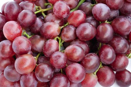 racimos de uvas: Una uva es una baya de fructificaci�n de las enredaderas de hojas caducas del g�nero bot�nico Vitis. Foto de archivo