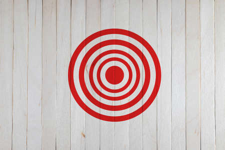 archery target: target on wood wall Stock Photo