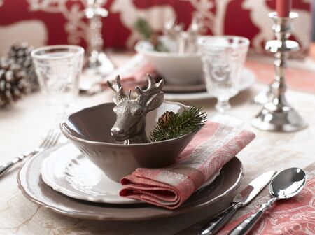 Christmas table set for holiday dinner party   shallow DOF  photo