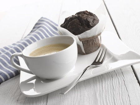 capuccino: Capuccino coffee cup with muffin on white table