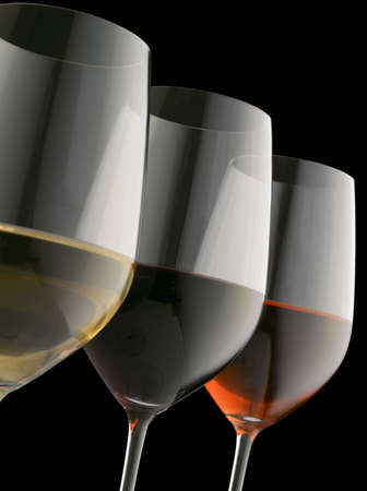 Glasses of red, white and rose wine on black background (Shallow focus. Focus on red wine) photo