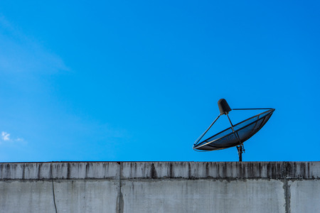 A Satellite Dish Above On Blue Sky Background