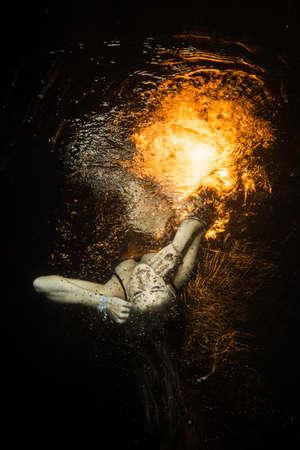 levitate: levitates girl unconscious underwater