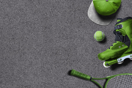 Green sporting goods on asphalt ground