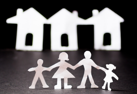 Paper cut family with housing photo