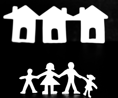 Paper cut family with background house photo