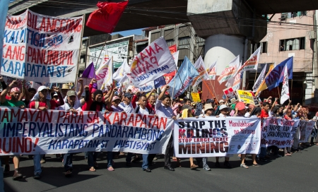 stormed: Manila, Philippines-December 10, 2012: Protest stormed the 64th Universal Declaration of Human Rights in Manila