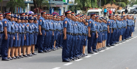 Manila, Philippines- December 14, 2012: Oath taking in Camp Crame of the new members of Philippine National  Police.Total of 1,014 has been added to the officer  corps of the after they were commissioned under the 2012 Stock Photo - 16869909