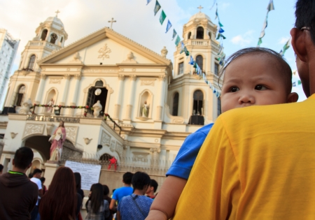catholic mass: Quiapo, Philippines-January 6, 2013: First Sunday Catholic mass before the celebration of the feast of Black Nazarene in Quiapo church where 11 million devotees are expected to attend the day-long religious procession.