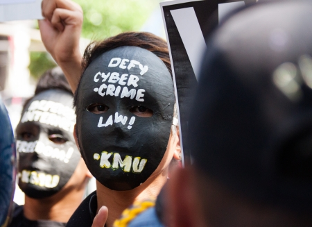 constitutional law: January 15, 2013- Anti-cybercrime law protest near the supreme court in Manila,Philippines. Activists wearing black mask angrily asked to strike down the controversial law for allegedly infringing on constitutional rights.