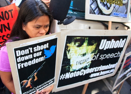 allegedly: January 15, 2013- Anti-cybercrime law protest near the supreme court in Manila,Philippines. Activists angrily asked to strike down the controversial law for allegedly infringing on constitutional rights.