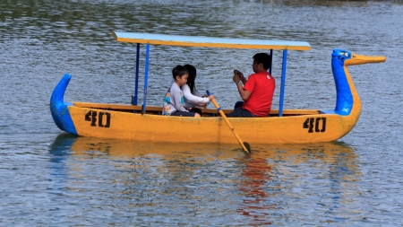 burnham: Baguio City, Philippines- May 23, 2013: Family enjoying boating activity during early morning in Burnham Park, one of the main tourist attraction in the summer capital of the country. Editorial