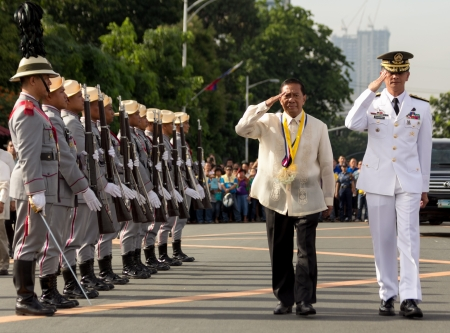 millitary: Luneta Park, Philippines -June 12, 2013: Philippines Vice President Jejomar Binay lead flag-raising ceremonies marking the 115th Independence Day of the country from the colonial rule of spain since 1898 in Cavite, Philippines.