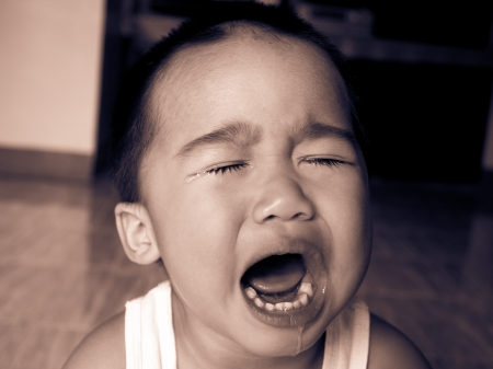 temper: Baby boy crying Stock Photo