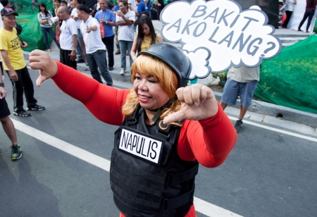 marched: Metro Manila, Philippines- October 4, 2013  Thousands of Filipinos marched in the  Million People march  in the nations financial district to condemn politicians for the misuse of their Priority Development Assistance Fund commonly called  Pork Barre
