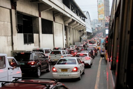 uneducated: Metro Manila, Philippines - October 4, 2013  Heavy traffic congestion in part of EDSA-Guadalupe during the rush in the afternoon, according to some studies that daily traffic is cause by uneducated and undisciplined drivers, inadequate traffic enforcement