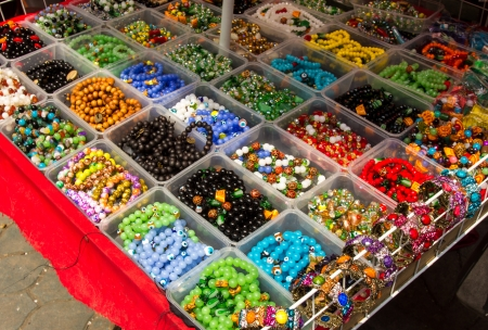 disctrict: Manila, Philippines- October 25, 2013  Assorted display of chinese bead bracelets in the street of Philippines shopping disctrict
