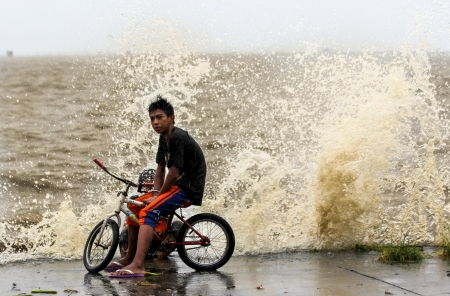 endangering: Laguna de bay, Philippines - November 8, 2013  Typhoon Haiyan s, an equivalent category 5 hurricane, endangering 25 million Filipinos in its path as it unleashed its fury  The hurricane is one of the biggest to ever hit land according to scientists