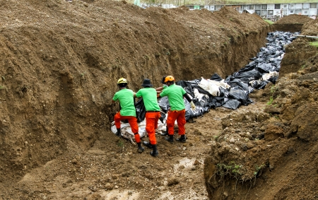 calamity: Tacloban City, Leyte - November 16, 2013  A total of 393 cadavers, in black bags, were laid in a mass grave nearby a public cemetery in the northern part of the city in the aftermath of typhoon Haiyan  Only 10-15 percent of the bodies were identified  Editorial
