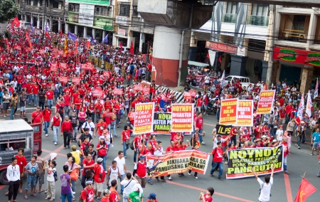 alleged: Manila, Philippines-November 30, 2013  Filipinos throughout the country held protests during the 150th anniversary of the country s working class hero Andres Bonifacio against the present president for alleged criminal negligence after typhoon Yolanda