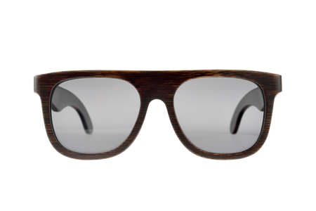 Wooden dark brown sunglasses with gray glasses on white background