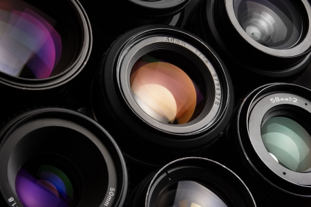 Group of colorful camera lenses photo