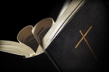 pages of a bible curved into a heart shape Stock Photo