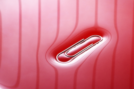 Office paper clip on red background Stock Photo - 11015502