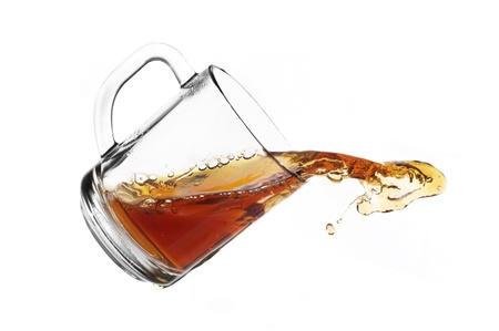 tea splash in glass cup isolated Stock Photo