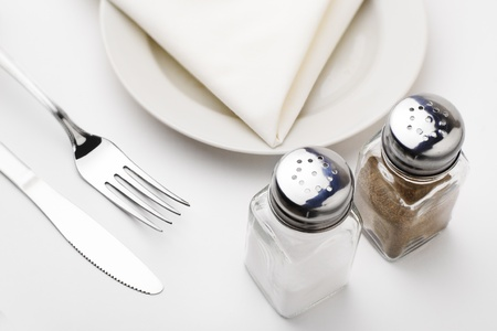 Empty served restaurant table with white tablecloth photo