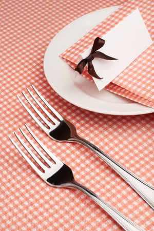 Empty served restaurant table with tablecloth, napkin and guest card Stock Photo