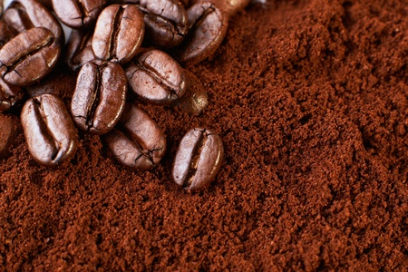 background with coffee beans and ground coffee. Macro
