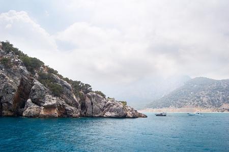 Yacht with tourists near the island photo