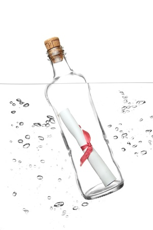 Message in a bottle floating in water with bubbles Stock Photo - 11261094