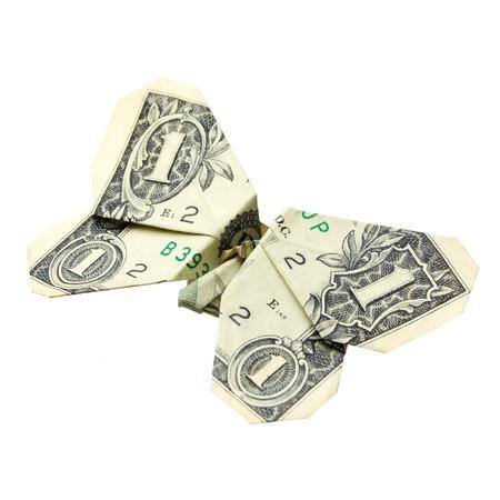 dinero volando: d�lar doblado estilo origami en una mariposa. Aislado sobre fondo blanco