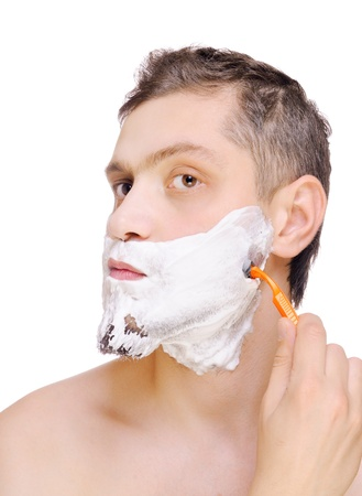 Portrait of a young man shaving. Isolated on white background Stock Photo - 11768146