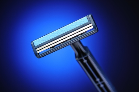 Double-blade shaver closeup. Blue color. Stock Photo - 12435459