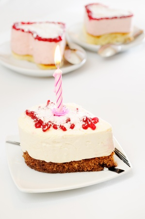 Cake with a candle on white table photo