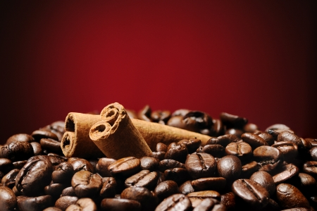 Heap of coffee beans with cinnamon sticks