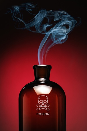 Steaming bottle of poison with skull and bones Stock Photo - 12435540