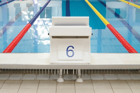 Swimming pool starting place with clearly marked lanes photo