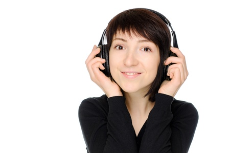 Young woman listen the music over white background photo