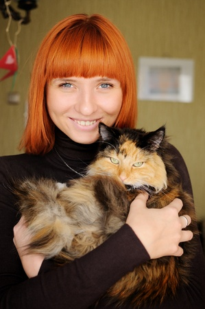 Portrait of beautiful smiling woman with cat