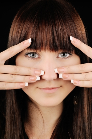 Close-up portrait of beautiful brunette girl with manicure photo