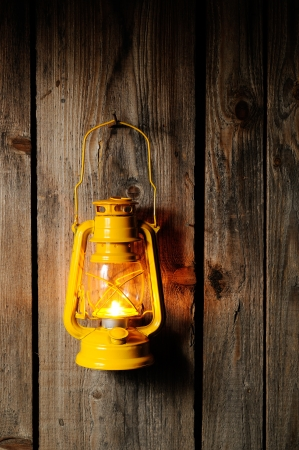 The old kerosene lantern hanging on the wooden wall photo