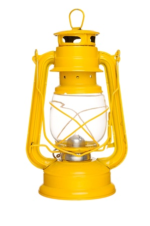 Old yellow kerosene lantern isolated on white background photo