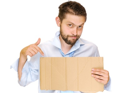 Fired businessman with messy cardboard frame  Isolated on white photo